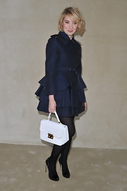 Deborah Francois opted for a girlier version of the classic trench in a navy tiered skirt topper.