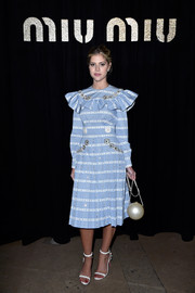 Lala Rudge donned a blue and white striped ruffle dress by Miu Miu for the label's fashion show.