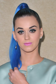 Katy Perry wore bright aqua blue eyeliner and false lashes at the Miu Miu fall 2012 fashion show in Paris.