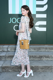 Mackenzie Foy attended the Miu Miu Club 2020 event carrying a cute straw shoulder bag.