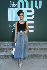 Tessa Thompson teamed her top with a denim midi skirt.