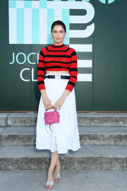 Laetitia Casta looked cute in a red and black striped crop-top by Miu Miu during the brand's Club 2020 event.