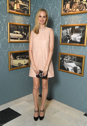 Lauren Santo Domingo went for an adorable '60s look with this pale-pink leather shift dress by Miu Miu during the brand's Cruise Collection show.