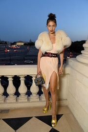 Bella Hadid was in the mood for pastels, pairing her pink dress with yellow platform sandals.