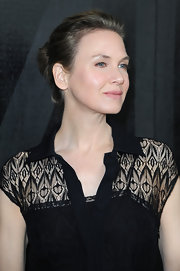 Renee Zellweger kept her beauty look minimal at the Miu Miu runway show where she rocked this simple twisted bun.