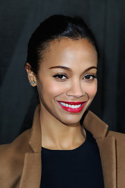 Zoe Saldana's dark chocolate tresses were sleek and sophisticated in a twisted bun.