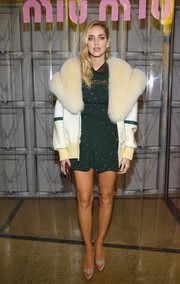 Chiara Ferragni topped off her outfit with a sporty-glam fur-collar jacket, also by Miu Miu.