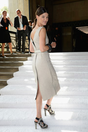 Hanneli Mustaparta looked head-to-toe chic in a gray sheath and a pair of multitextured strappy sandals at the Miu Miu fashion show.