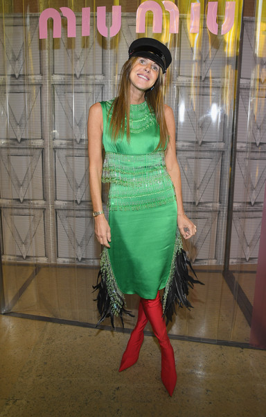 Anna dello Russo caught eyes with this fringed and feathered green dress by Prada at the Miu Miu Spring 2018 show.