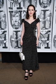 A white Miu Miu bag with a gold chain strap rounded out Rachel Brosnahan's ensemble.