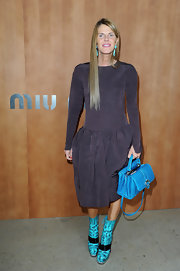 Anna dello Russo added an extra pop of color with a bright blue crocodile tote by Paula Cademartori.