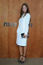 We love the '70s simplicity of Marie-Ange's long-sleeve white shirtdress.