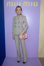 Diane Kruger added a bright pop with an embellished pink shoulder bag, also by Miu Miu.