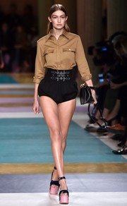 Gigi Hadid was classic up top in a khaki safari shirt during the Miu Miu runway show.
