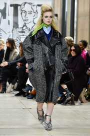 A black leather purse rounded out Elle Fanning's catwalk attire.