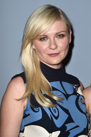 Kirsten Dunst swept her platinum-blonde locks to one side for the 'Miu Miu Women's Tales #7 - #8' premiere.