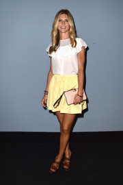 Nicoletta Romanoff finished off her cute outfit with a yellow Miu Miu mini skirt.