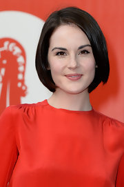 Michelle Dockery opted for mod inspiration for her sleek bob at the Miu Miu event in Italy.