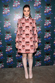 Hailee Steinfeld amped up the retro feel with a pair of knee-high pink lace-up boots by Miu Miu.
