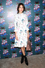 Alexa Chung looked very ladylike in a high-neck floral dress by Miu Miu during the 'Spark & Light' screening.