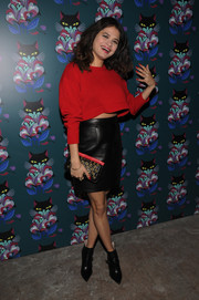 Melonie Diaz kept the red-black theme going with a studded Miu Miu clutch.