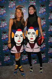 Giovanna Battaglia looked so fun in her Prada face-print dress she probably didn't mind that Anna dello Russo was wearing the same dress.