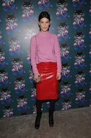 Hanneli Mustaparta styled her turtleneck with a fierce red leather skirt.