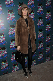 Anya Ziourova teamed her fur coat with a pair of vintage-chic metallic pumps.