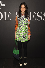 Leandra Medine completed her retro look with a pair of white ankle-strap pumps.