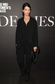 Crystal Renn suited up in this baggy black number for the 'De Djess' screening.