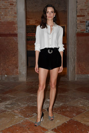 Stacy Martin kept it relaxed yet chic in a white silk button-down at the Miu Miu Women's Tales dinner.