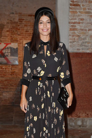 Alessandra Mastronardi attended the Miu Miu Women's Tales dinner carrying a chic gemstone-adorned clutch.
