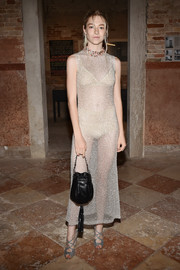 Hunter Schafer flashed plenty of skin in a sheer gold dress at the Miu Miu Women's Tales dinner.