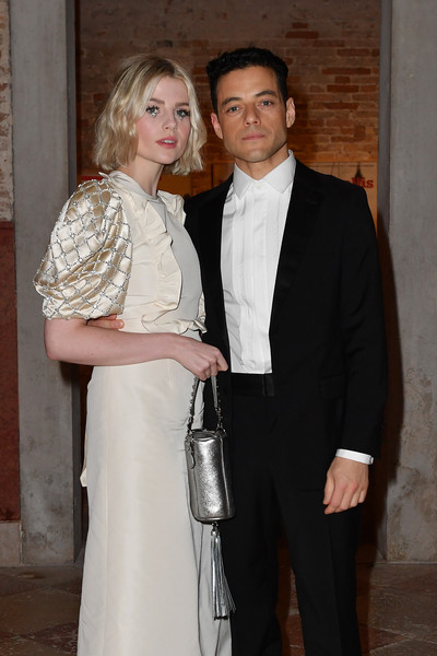More Pics of Lucy Boynton Metallic Purse (1 of 3) - Lucy Boynton Lookbook - StyleBistro [suit,formal wear,fashion,event,tuxedo,outerwear,dress,haute couture,blazer,fashion design,venice,italy,miu miu womens tales dinner,venice film festival,rami malek,lucy boynton]