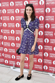 Stacy Martin kept it breezy in a purple print mini dress at the Miu Miu photocall during the 2019 Venice Film Festival.