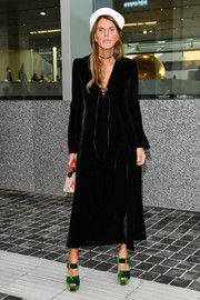 Anna dello Russo injected some color with a pair of emerald-green velvet platform sandals, also by Prada.