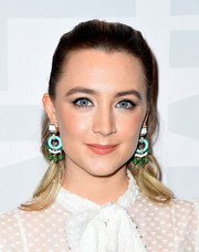 Saoirse Ronan jazzed up her look with a pair of colorful statement earrings by David Webb.