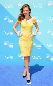 Miranda Kerr's yellow lace frock showed off her summery style while out in NYC.