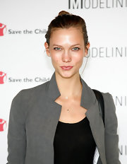 Karlie Kloss was fresh faced at the Modelinia Beautiful Friends Forever bracelet launch with her hair in a neat top knot.