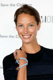 Christy Turlington arrived sans makeup to Moldelinia Beautiful Friends Forever Bracelet Launch. Just a hint of gloss kept her lips supple. Lip Smackers Lip Gloss is always a fun, flavorful option for recreating her natural look.