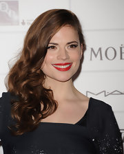 Hayley Atwell wore her hair in long side-swept curls at the 2011 Moet British Independent Film awards.