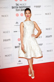 Gugu Mbatha-Raw completed her breathtakingly elegant ensemble with a Michael Kors satin clutch.