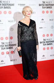 Helen Mirren went for a goth vibe in a black lace gown with an asymmetrical neckline during the Moet British Independent Film Awards.