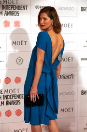 Sienna Guillory was sexy-chic at the Moet British Independent Film Awards in a blue cocktail dress with an open back and drapey detailing.