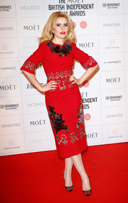 Paloma Faith struck a pose on the red carpet wearing a flower and key-embroidered red dress by Dolce & Gabbana during the Moet British Independent Film Awards.
