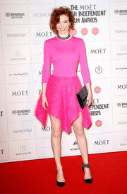 Eleanor Tomlinson accessorized her vibrant dress with a studded black clutch.