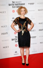 Myanna Buring looked dazzling in a star-sequined cocktail dress during the Moet British Independent Film Awards.