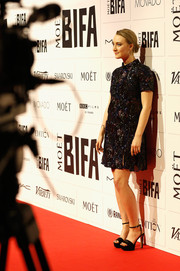 Saoirse Ronan teamed black platform sandals with a sparkly mini dress for the Moet British Independent Film Awards.