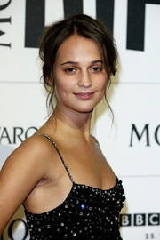 Alicia Vikander attended the Moet British Independent Film Awards sporting a messy-sexy updo.