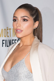 Olivia Culpo looked super chic with her sleek, partially braided ponytail at the Moet Moment Film Festival.